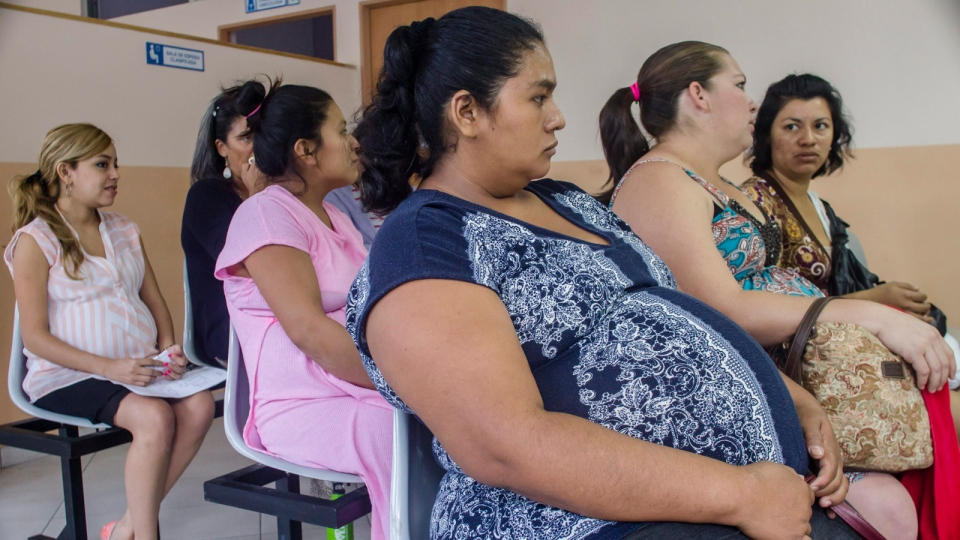 In this Jan. 29, 2016 photo, women wait their turn for their pre-natal exams at the National Hospital for Women in San Salvador, El Salvador. (AP / Salvador Melendez)