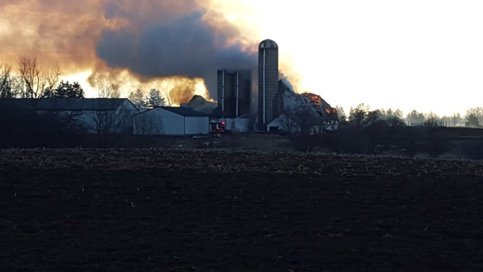 Smoke and flames were visibile as firefighters battled a large barn fire across from the former Ford plant in Elgin County on Monday, Feb. 1, 2016. (Justin Zadorsky / CTV London)