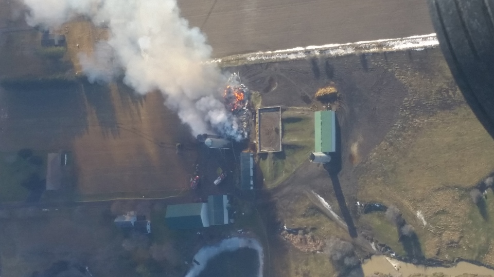 An aerial photo of the barn fire at Prikken Farms Ltd. south of London, Ont. on Monday, Feb. 1, 2016 was taken from a Cessna four-seater airplane. (Allan Cox)