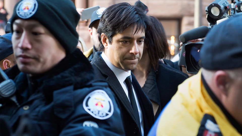 Jian Ghomeshi leaves a Toronto courthouse after the first day of his trial on Monday, Feb. 1, 2016. (Frank Gunn / THE CANADIAN PRESS)