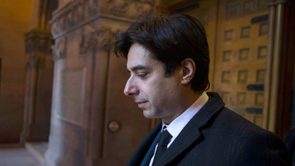 Former CBC radio host Jian Ghomeshi leaves a Toronto court after the first day of his trial on Monday, February 1, 2016. (THE CANADIAN PRESS / Chris Young)