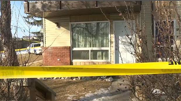 Police tape blocks off a condo complex in the Ranchlands area.