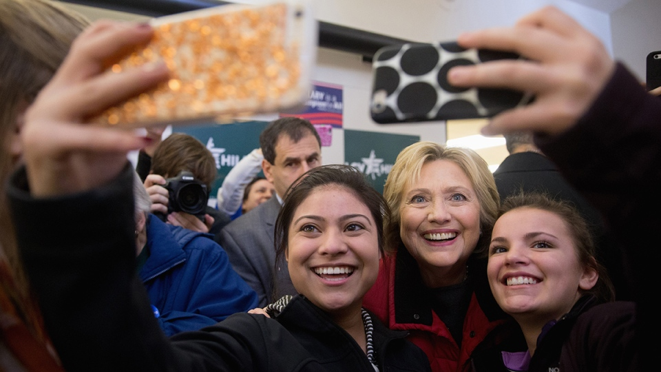 Democratic presidential candidate Hillary Clinton takes photos with workers at her campaign office in Des Moines, Iowa, Monday, Feb. 1, 2016. (AP / Andrew Harnik)
