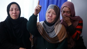 Zahara Mirzaee, the mother of victim Zainab Mirzaee, speaks to the media during the funeral ceremony in Kabul, Afghanistan on Thursday, Jan. 21, 2016. The Taliban suicide bombing against a bus carrying employees of Afghanistan's biggest media company on Jan. 20 has shocked local journalists. (AP / Massoud Hossaini)