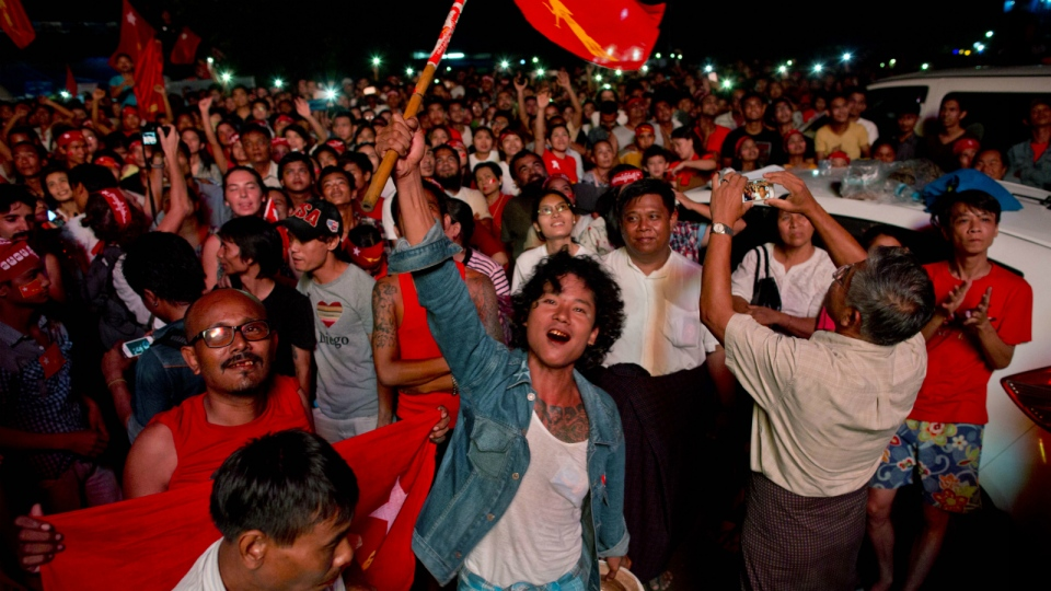 Supporters of Myanmar's National League for Democracy party celebrate as election results are posted outside the NLD headquarters in Yangon, Myanmar on Monday, Nov. 9, 2015. (AP / Gemunu Amarasinghe)