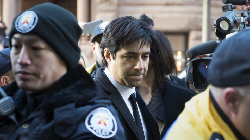 Jian Ghomeshi leaves a Toronto courthouse after the first day of his trial on Monday, Feb. 1, 2016. (Frank Gunn/THE CANADIAN PRESS)