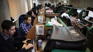 Iranian stockbrokers monitor share prices at the Tehran Stock Exchange in Tehran, Iran, on Feb. 2, 2016. (Vahid Salemi / AP)
