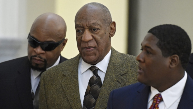 Bill Cosby, centre, arrives for a court appearance