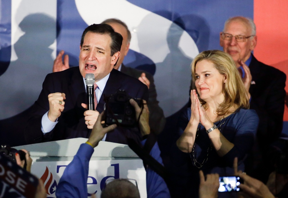 Republican presidential candidate, Sen. Ted Cruz, R-Texas, speaks during a caucus night rally as his wife Heidi listens Monday, Feb. 1, 2016, in Des Moines, Iowa. (AP / Chris Carlson)