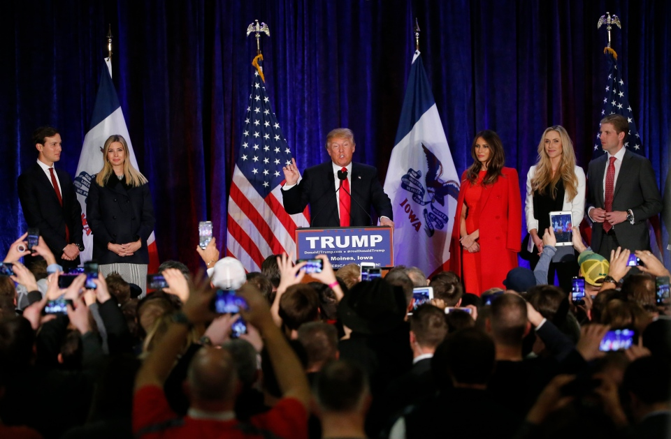 Republican presidential candidate, businessman Donald Trump speaks as he is surrounded by his family at his caucus night rally, Monday, Feb. 1, 2016, in West Des Moines, Iowa. (AP / Kiichiro Sato)