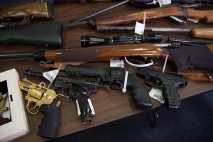 Guns of different sorts are displayed at the RCMP detachment in Burnaby, B.C. Tuesday, April 28, 2015. (Jonathan Hayward/THE CANADIAN PRESS)
