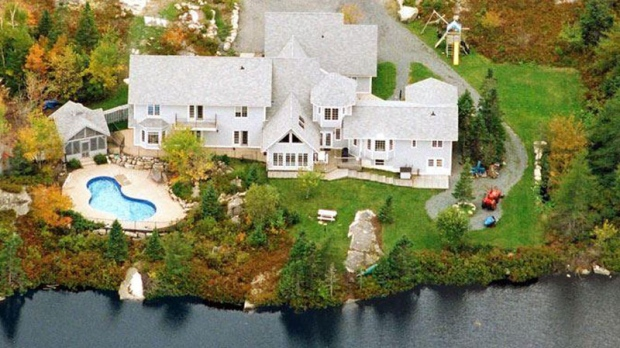 Just a 20 minute drive from Halifax, this waterfront home sits on 650-feet of lake frontage – but still has a heated pool and glass pool house. The $1.2-million estate has five-bedrooms, two separate dining rooms, a grand sunroom overlooking the lake, three decks and a three-car garage.  (Realtor.ca/Shari Johnson)