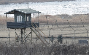 In this Jan. 23, 2016, photo, South Korean army soldiers patrol along the barbed-wire fence in Paju, near the border with North Korea. (AP / Ahn Young-joon)