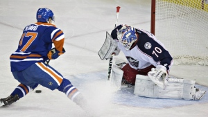 Columbus Blue Jackets goalie Joonas Korpisalo is scored on by Edmonton Oilers' Connor McDavid during second period NHL action in Edmonton, Alta., on Tuesday, Feb. 2, 2016. (Jason Franson / THE CANADIAN PRESS)