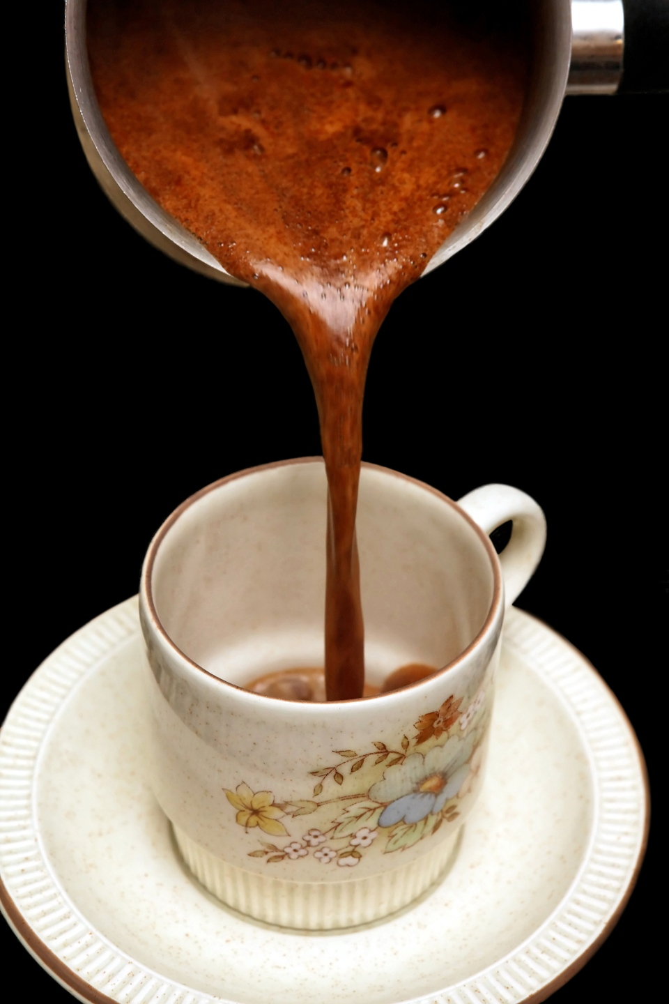 A cup of coffee is shown. (Dimitrios Rizopoulos / shutterstock.com)