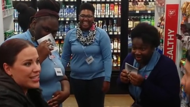Stacey Kay, left, raps with employees at a U.S. Walgreens in a video posted to Facebook on Jan. 28, 2016.