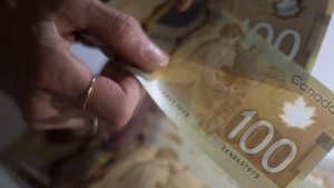 Canadian $100 bills are counted in Toronto on Tuesday, Feb. 2, 2016. (Graeme Roy /THE CANADIAN PRESS)