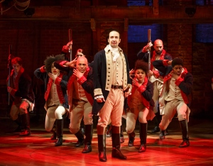 This image released by The Public Theater shows Lin-Manuel Miranda, foreground, with the cast during a performance of 'Hamilton,' in New York. (Joan Marcus/The Public Theater via AP)