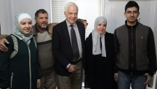 Immigration Minister John McCallum with refugees