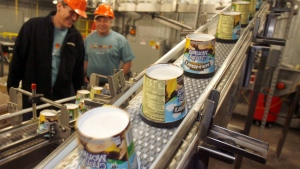 In this file photo taken March 23, 2010, ice cream moves along the production line at Ben & Jerry's Homemade Ice Cream in Waterbury, Vt. (AP/Toby Talbot)