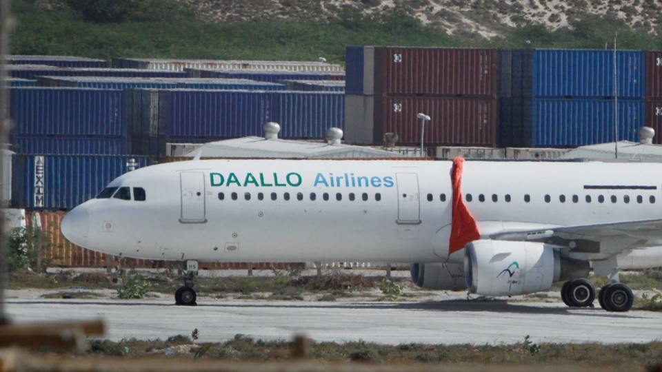 The Daallo Airlines plane that was forced to make an emergency landing late Tuesday, sits in the airport in Mogadishu, Somalia, Wednesday, Feb. 3, 2016. (AP / Farah Abdi Warsameh)