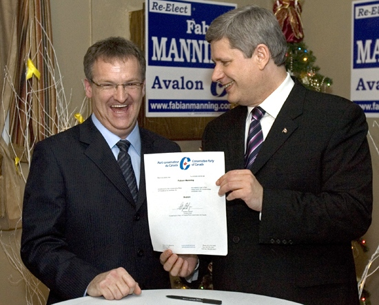 Prime Minister Stephen Harper shares a laugh with Avalon MP Fabian Manning after signing his nomination papers in Holyrood, N.L., on Friday, Nov. 30, 2007. (Andrew Vaughan / THE CANADIAN PRESS)