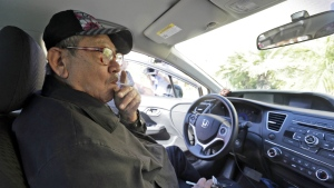 Long Hoang Ma, a California taxi driver held hostage for a week by three escaped inmates, sits inside his taxi during an interview at the offices of Vietnamese-language newspaper Nguoi Viet in Westminster, Calif. on Wednesday, Feb. 3, 2016. (AP / Nick Ut)