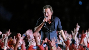 In this Feb. 1, 2009 file photo, Bruce Springsteen performs during halftime of the NFL Super Bowl XLIII football game between the Arizona Cardinals and the Pittsburgh Steelers in Tampa, Fla. (AP Photo/Mark J. Terrill)