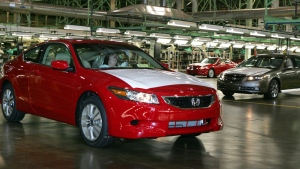 In this Nov. 1, 2007 file photo, a 2008 Honda Accord Coupe, left, is driven off the assembly line as a 2008 Acura TL waits during production at Honda of America Manufacturing's Marysville Auto Plant in Marysville, Ohio. (AP Photo/Paul Vernon)