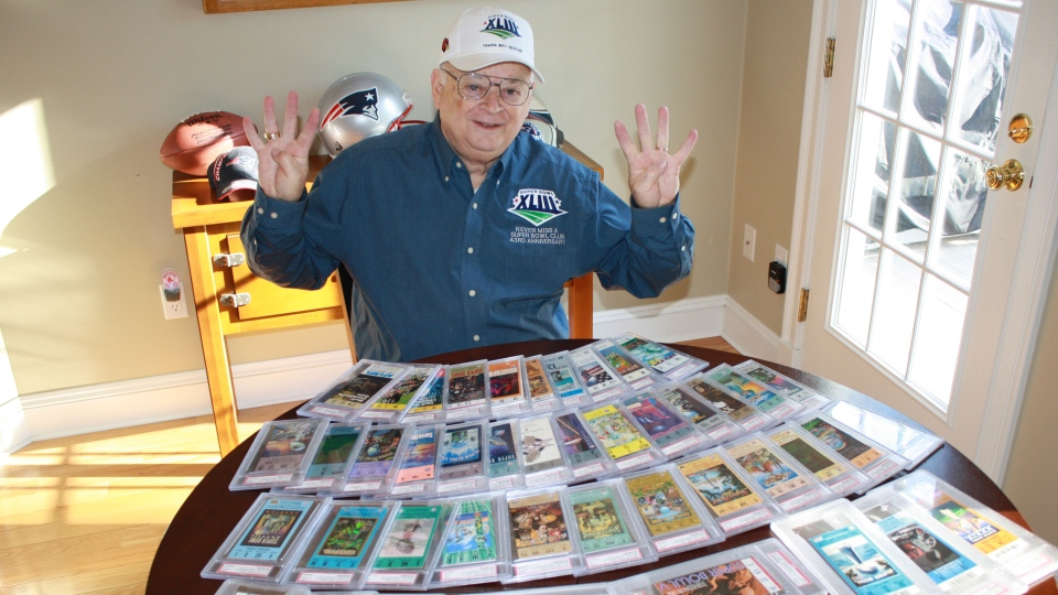 Don Crisman, 79, shows off mementos from his 49-game Super Bowl attendance streak.
