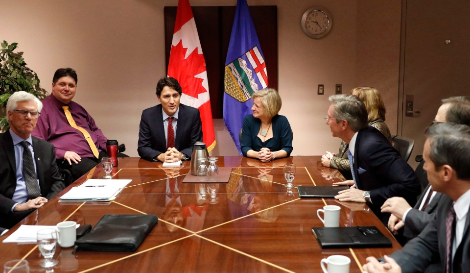 Prime Minister Justin Trudeau, centre left, and Alberta Premier Rachel Notley are seen at a roundtable meeting with oil and gas producers in Calgary, on Thursday Feb. 4, 2016. Top left is Veterans Affairs Minister Kent Hehr. (Larry MacDougal / THE CANADIAN PRESS)
