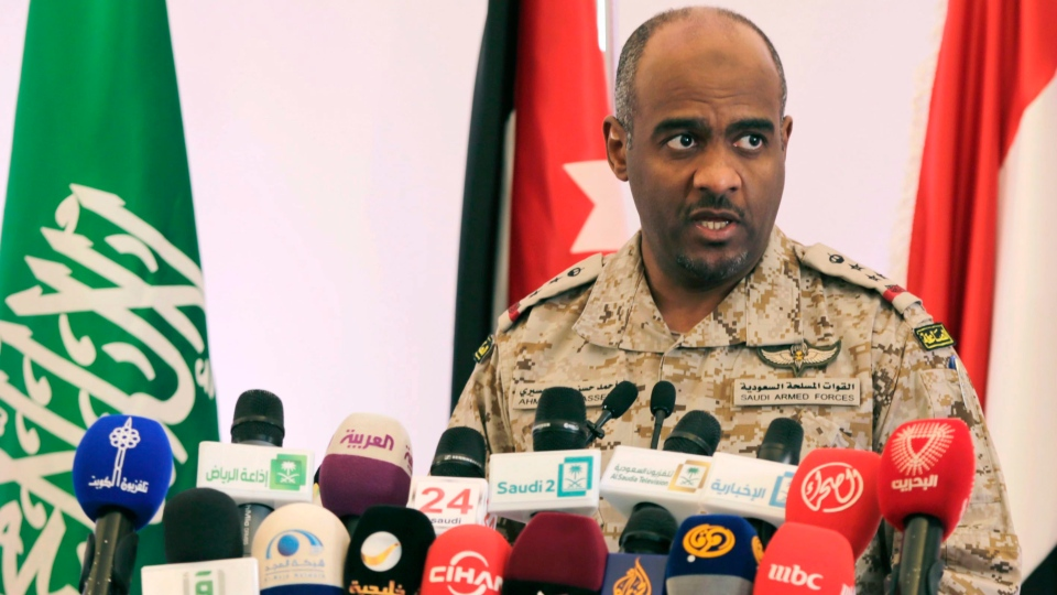 FILE - Military spokesman Ahmed Asiri briefs journalists on the Saudi-led coalition's strikes on Houthi rebels, in Riyadh, Saudi Arabia, on Saturday, April 18, 2015. (AP Photo/Hasan Jamali)