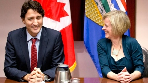 Prime Minister Justin Trudeau, left, and Alberta Premier Rachel Notley chat prior to a roundtable meeting with oil and gas producers in Calgary, on Thursday, Feb. 4, 2016. (Larry MacDougal / THE CANADIAN PRESS)
