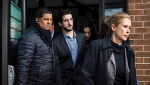 Marco Muzzo (centre) leaves the Newmarket courthouse surrounded by family members including his mother Dawn Muzzo (right) on Thursday, February 4, 2016. Muzzo was released on bail after pleading guilty to a fatal drunk driving crash resulting in the deaths of three children and their grandfather. THE CANADIAN PRESS/ Christopher Katsarov