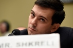 Pharmaceutical chief Martin Shkreli listens on Capitol Hill in Washington, Thursday, Feb. 4, 2016, during the House Committee on Oversight and Reform Committee hearing on his former company's decision to raise the price of a lifesaving medicine. (AP Photo/Susan Walsh)