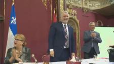 Premier Philippe Couillard smiles at caucus
