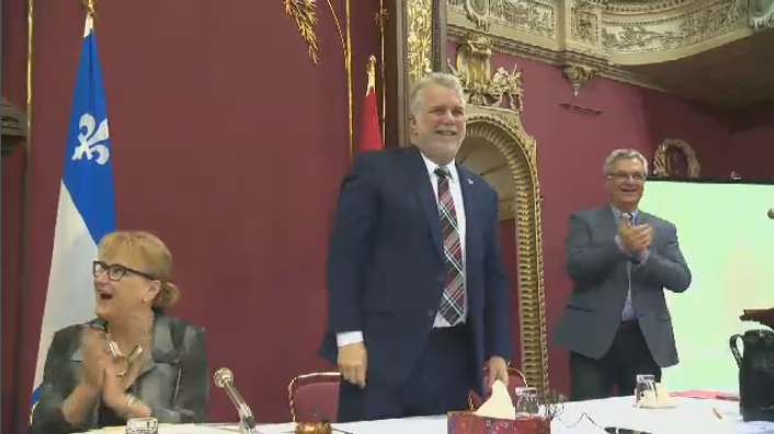 Premier Philippe Couillard smiles as his party's two-day pre-session caucus meeting begins in Quebec City Feb. 4, 2016.