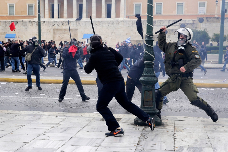 A riot policeman clash with protesters during a 24-hour nationwide general strike in Athens, Thursday, Feb. 4, 2016. (AP / Petros Giannakouris)