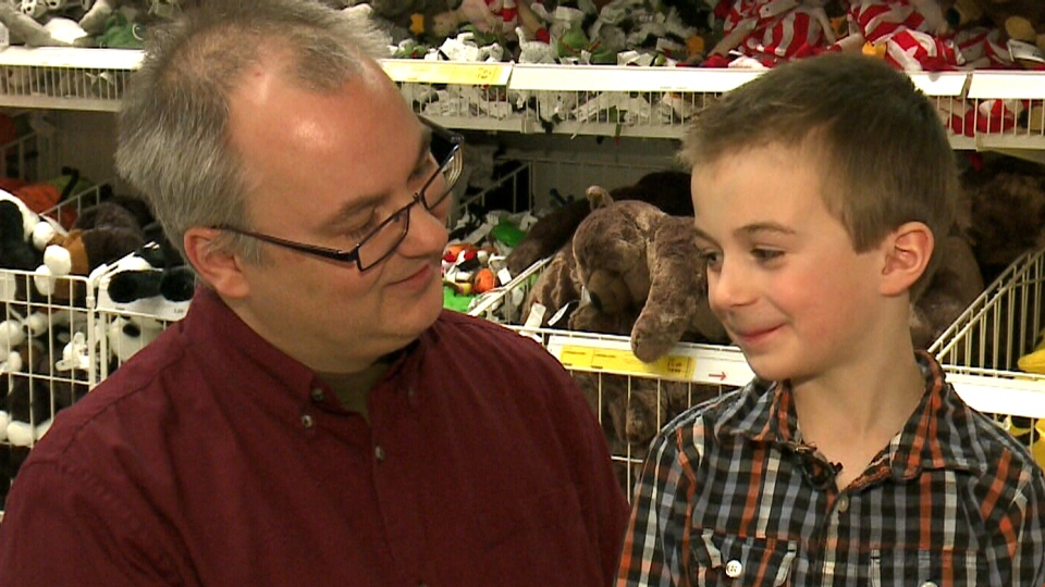 Leonard Belanger, 6, is seen with his father Francois Belanger. Leonard is one of ten winners of Ikea's international toy design contest.