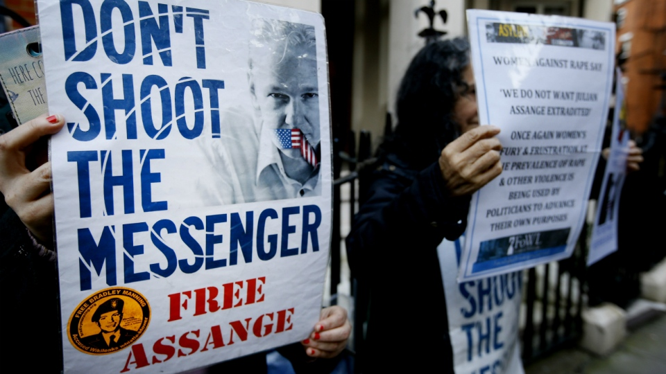 Demonstrators hold banners outside the Ecuadorean Embassy in London, where Wikileaks founder Julian Assange is staying on Thursday, Feb. 4, 2016. (AP / Kirsty Wigglesworth)