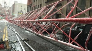 In this photo provided by the FDNY, debris and a mangled crane lie in the street in New York's Tribeca neighborhood following a deadly collapse on Friday, Feb. 5, 2016. (FDNY via AP)