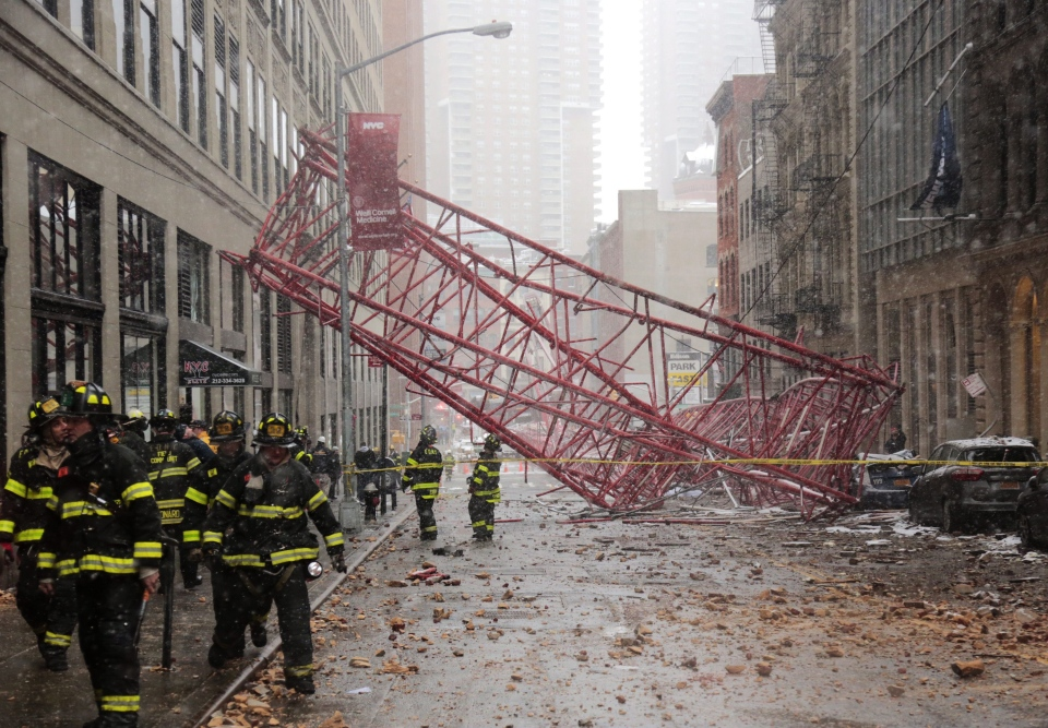 A collapsed crane lies on the street on Friday, Feb. 5, 2016, in New York. (AP / Bebeto Matthews)