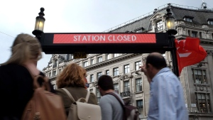 People pass the closed tube station entrance at Oxford Circus in London, Thursday, Aug. 6, 2015. (AP / Kirsty Wigglesworth)