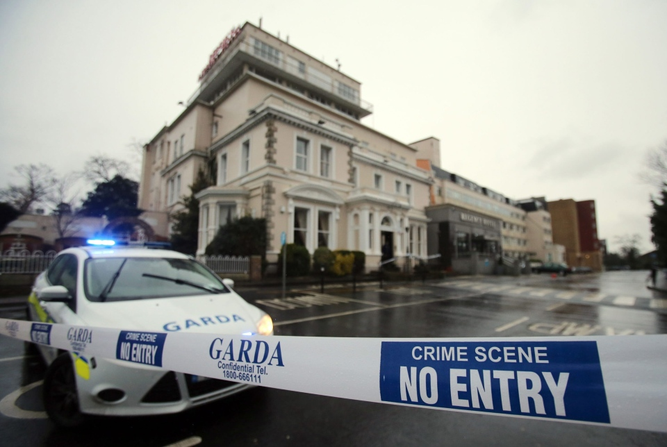A police (Garda) cordon outside the Regency Hotel in Dublin, Ireland, after one man died and two others were injured following a shooting incident at the hotel, Friday Feb. 5, 2016. (Niall Carson / PA)