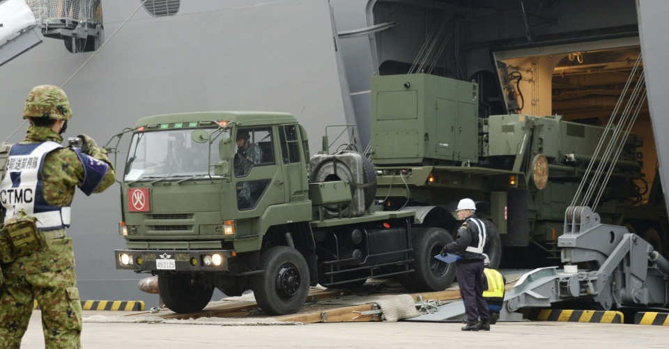 A vehicle carrying a PAC-3 missile interceptor arrives at a port on Ishigaki Island, Okinawa prefecture, southwestern Japan Saturday, Feb. 6, 2016. (Koji Harada/Kyodo News via AP)