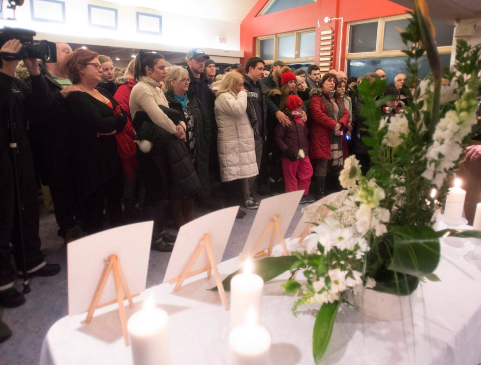 Family members, friends and local residents stands in a vigil for the six victims of a militant siege in Burkina Faso, Monday, January 18, 2016, in Lac Beauport, Quebec. (Jacques Boissinot/THE CANADIAN PRESS)