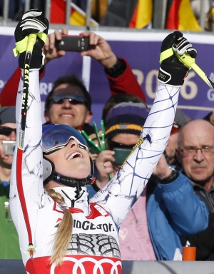 Lindsey Vonn, of the United States, celebrates after crossing the finish line during an alpine ski, women's World Cup downhill in Garmisch Partenkirchen, Germany, Saturday, Feb. 6, 2016. (AP/Giovanni Auletta)