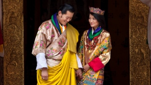 This Oct. 13, 2011 file photo Queen Jetsun Pema, right, looks at King Jigme Khesar Namgyal Wangchuck as they pose after they were married at the Punakha Dzong in Punakha, Bhutan. (AP / Kevin Frayer, File)