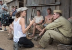 In this image released by Universal Pictures, director Angelina Jolie, left, speaks with Garrett Hedlund on the set of 'Unbroken.' (AP/Universal Pictures, David James)