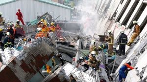 Rescue teams continue to search for the missing in a collapsed building, after an early morning earthquake in Tainan, Taiwan, Saturday, Feb. 6, 2016. A powerful, shallow earthquake struck southern Taiwan before dawn Saturday. (Wally Santana / AP)